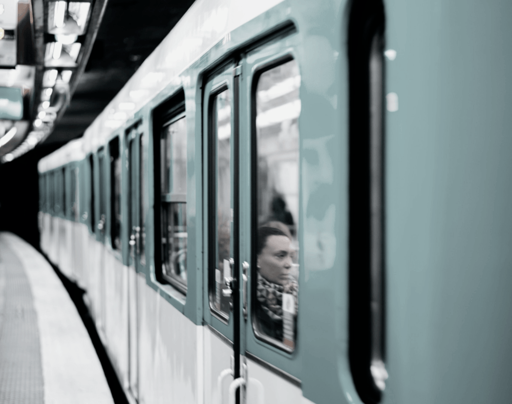 Subway Train with Woman Leaning Against Window
