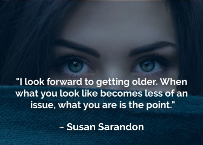 woman peeking over fabric and getting older quote by susan sarandon